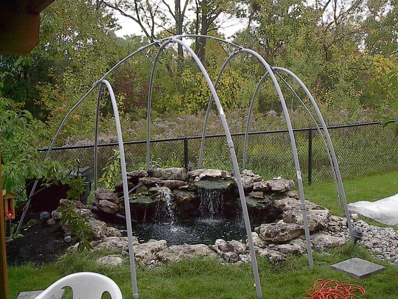 Setup greenhouse covering koi pond winter pond cover for Garden pond insert