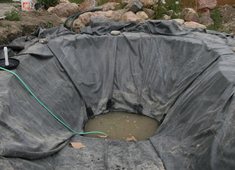 Pond liner installation taping liner folds epdm liner for Pond liner installation