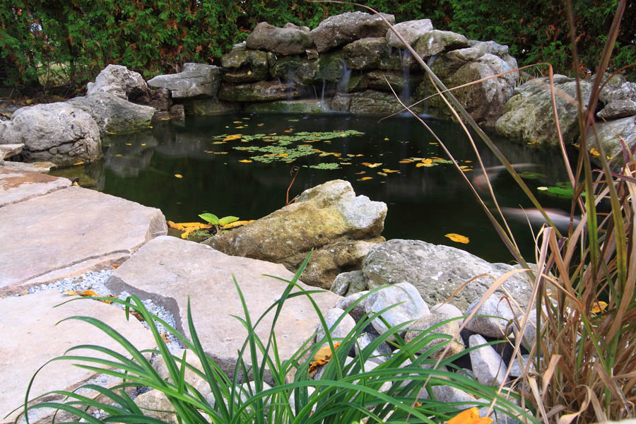 Waterfalls pictures show quality koi photos for How deep should a koi pond be