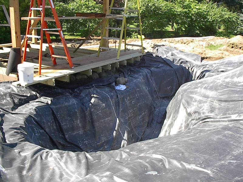 Photographs of a koi pond build for Building a pond with liner