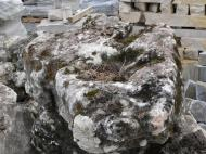 Limestone is very natural looking and will buffer you pH