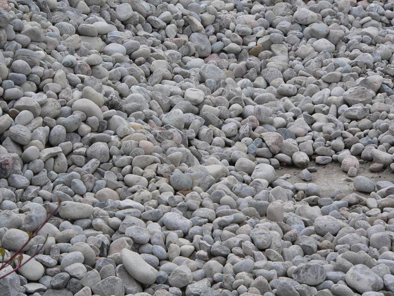 Types of stone and rock work for your pond for Koi pond rock bottom